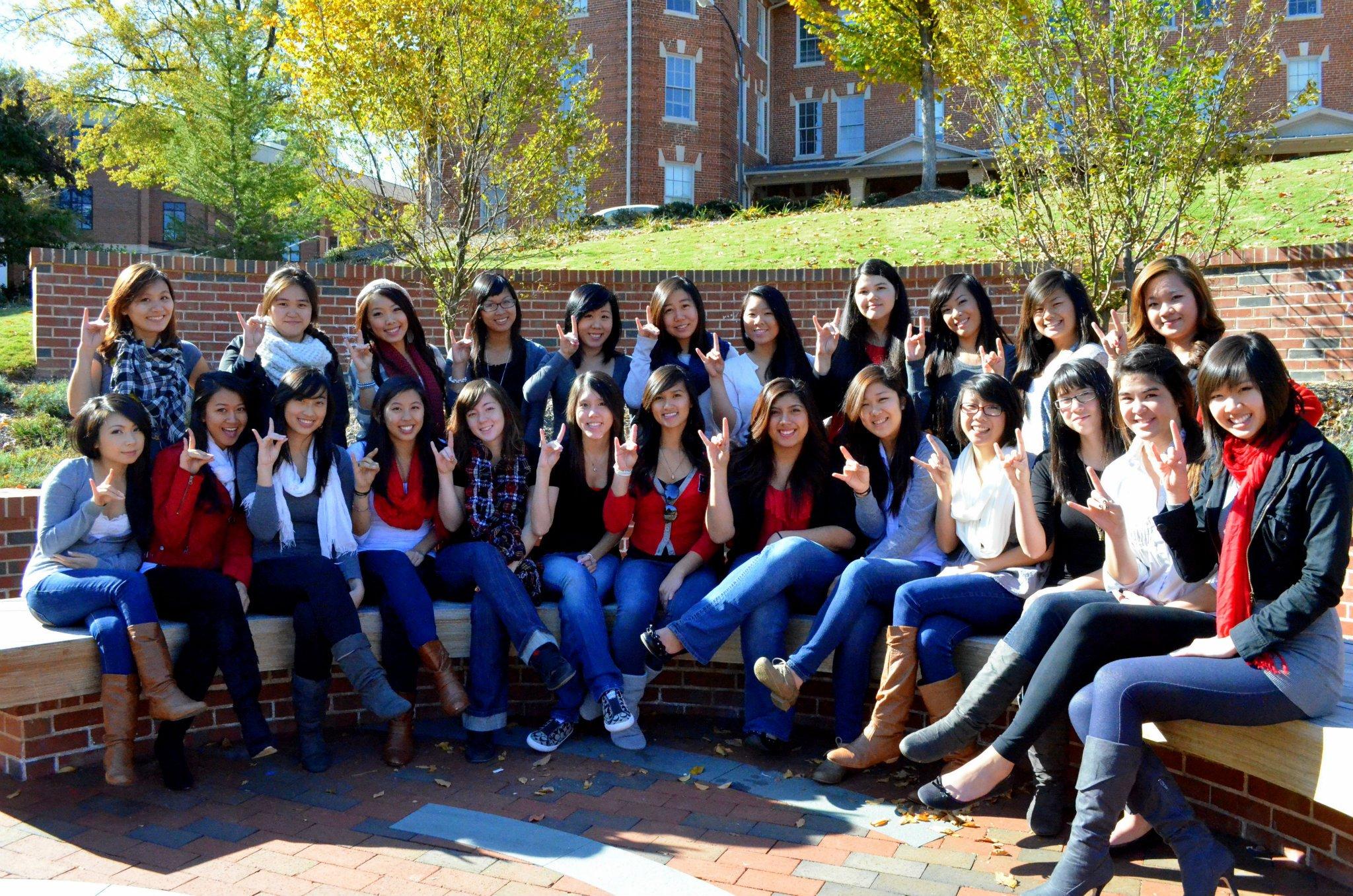 Asian sorority members show Wolfpack spirit.