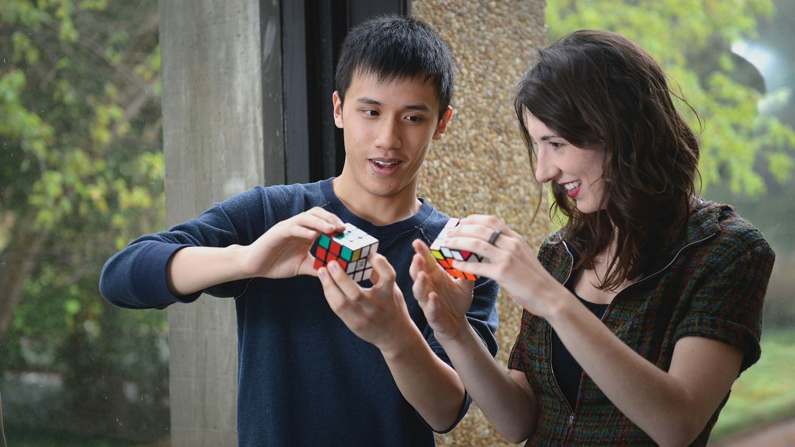 student with Rubik's Cube