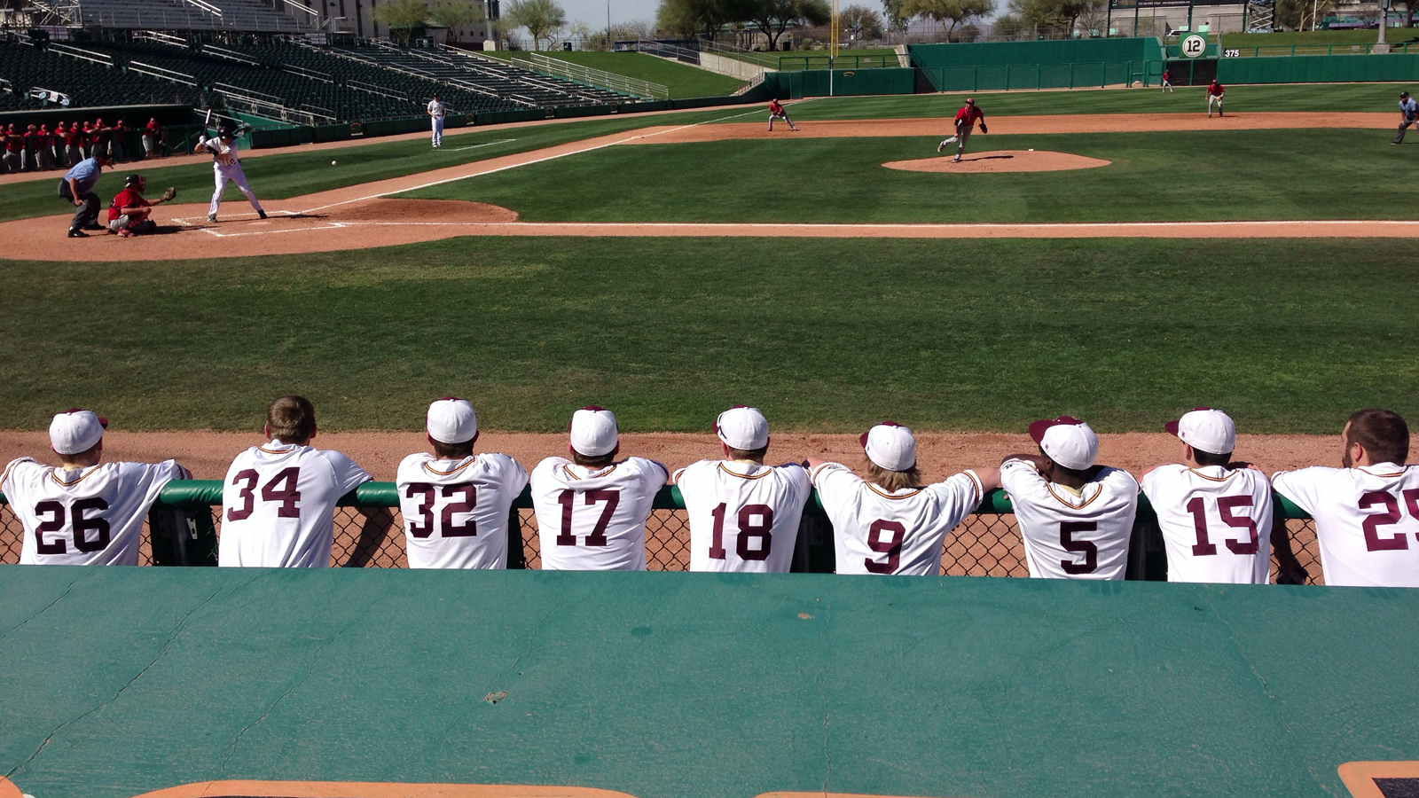 athletes looking at baseball diamond