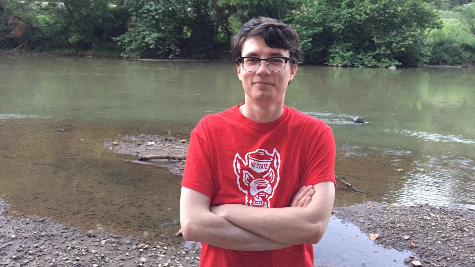 Jesse Young stands in front of a river