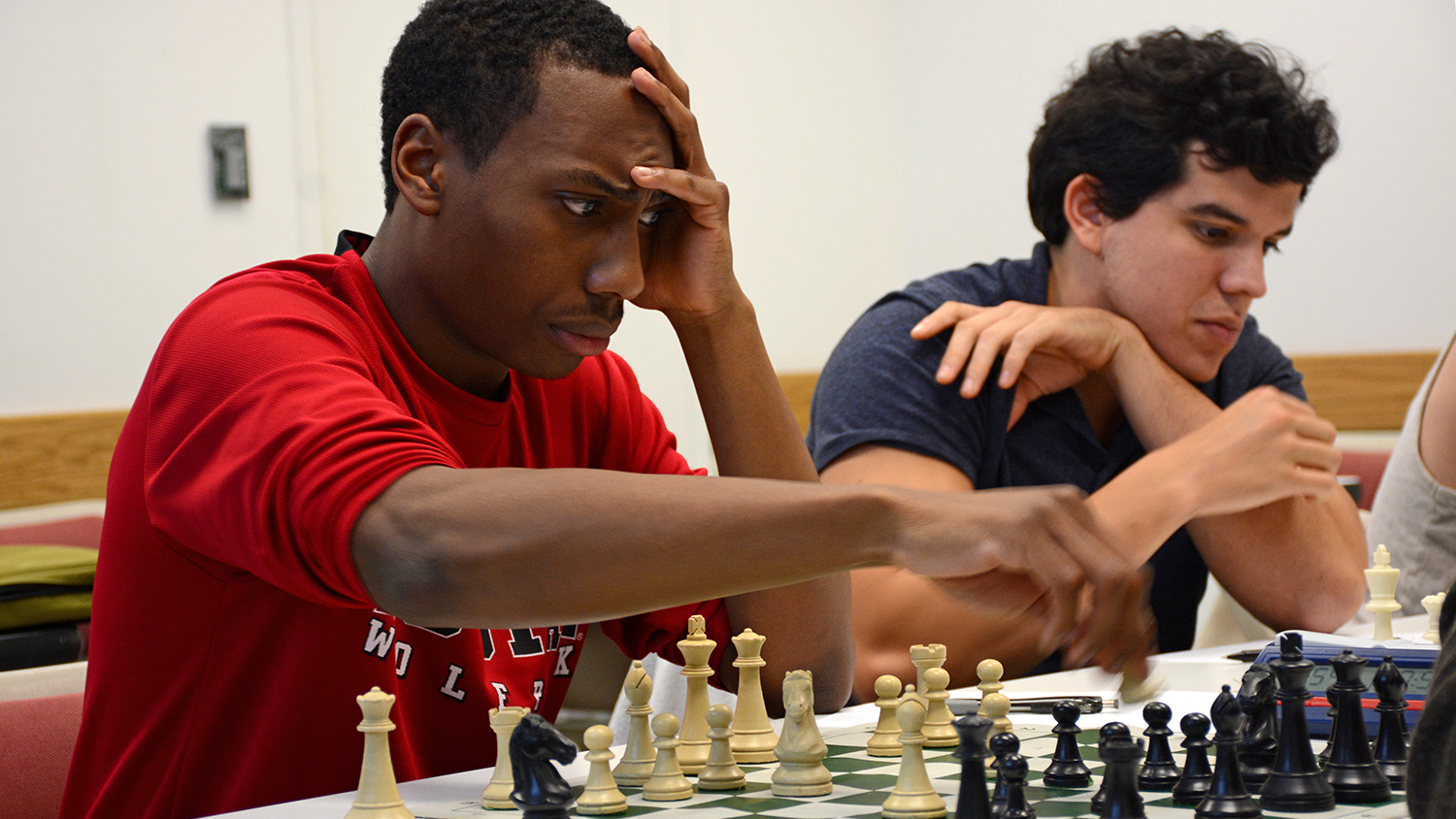Justin Lockett moves his chess piece
