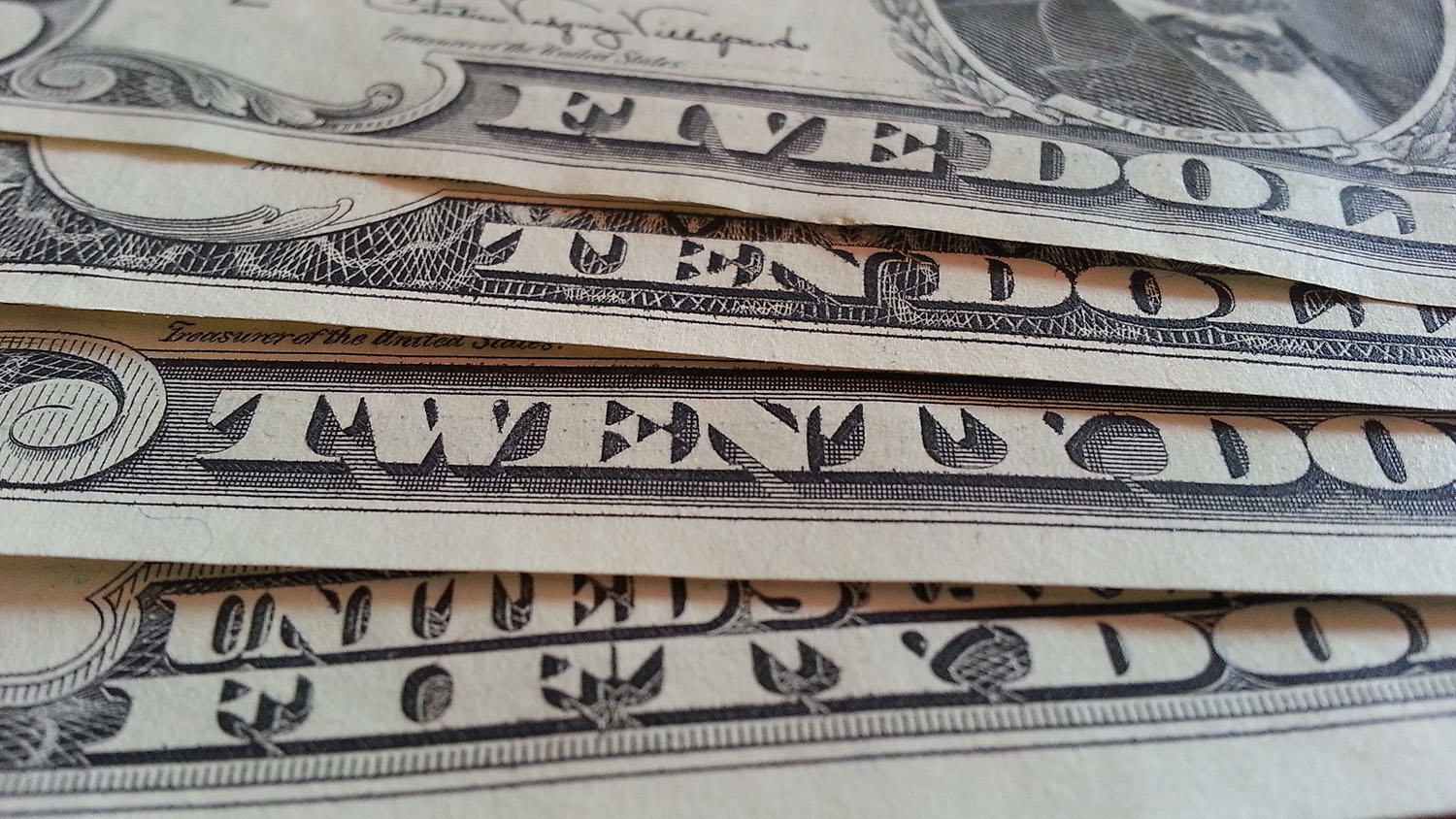 A close-up shot of twenty dollar bills.