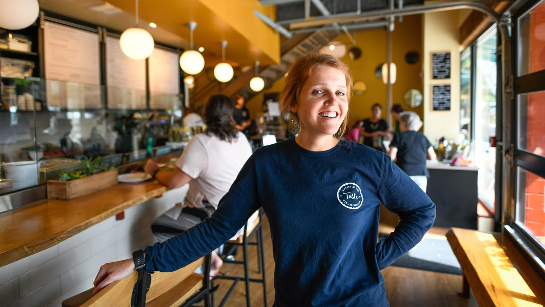 Maggie Kane poses inside her restaurant
