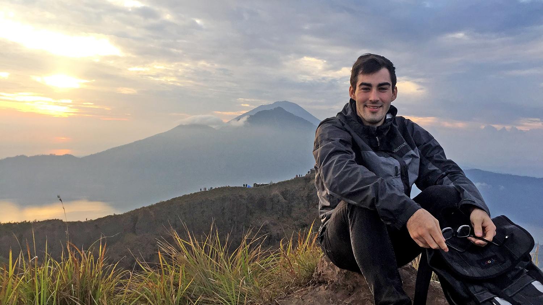 Sam Shain sits on a mountainside