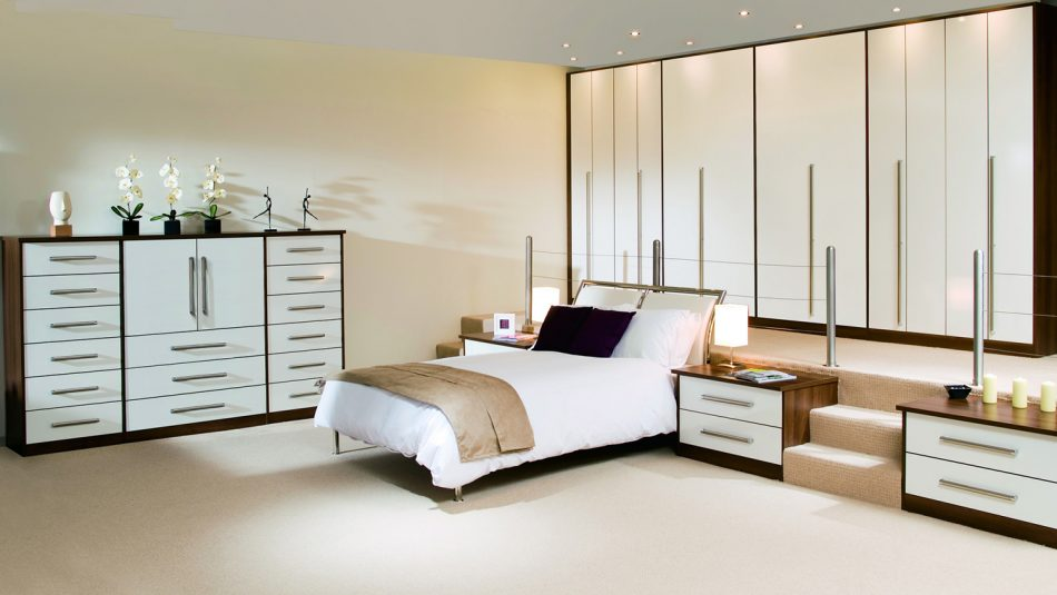A bed sits in the middle of a neatly-organized room.