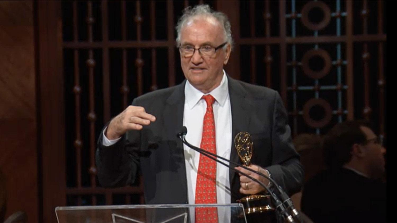 Walt Wolfram holding Emmy award