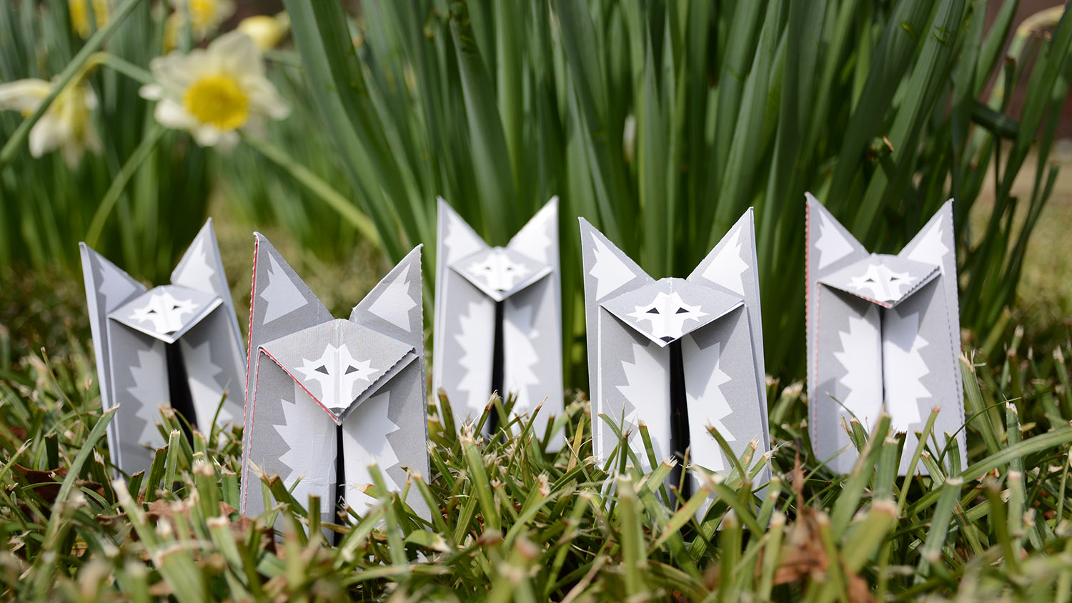 origami wolves sitting in grass
