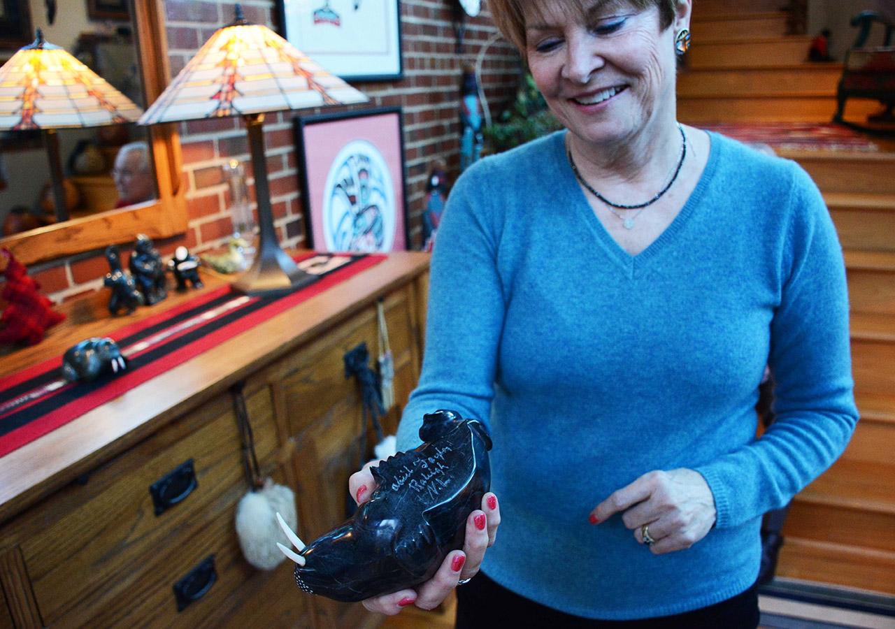 Belinda holding walrus artifact