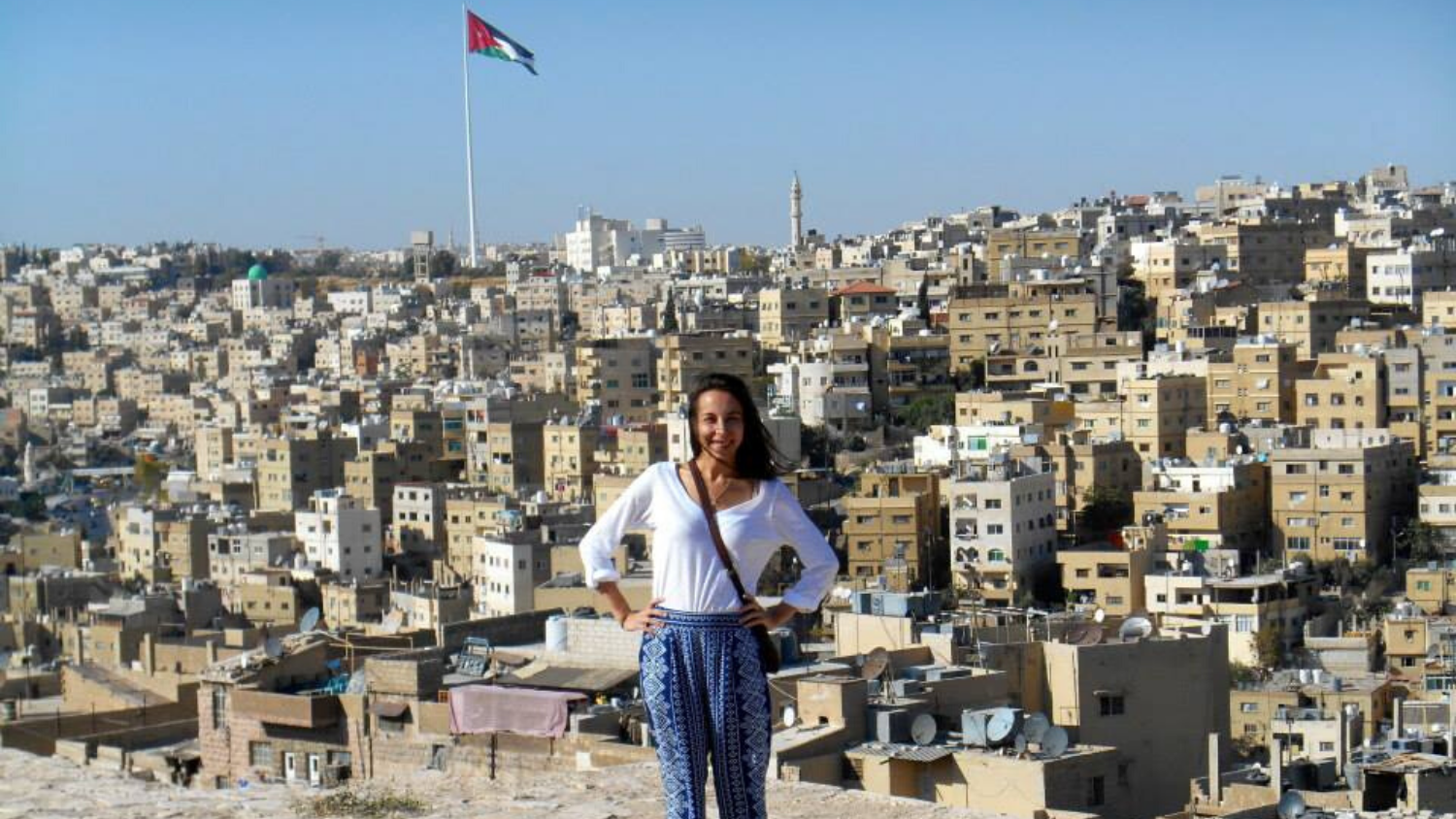 Tara standing in front of buildings abroad