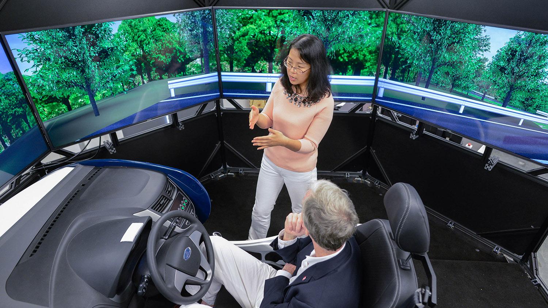 man sits in driving simulator