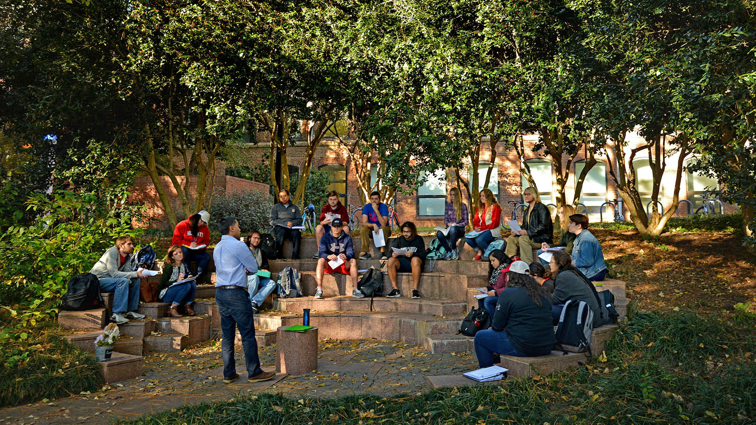 students sitting in outdoor classroom