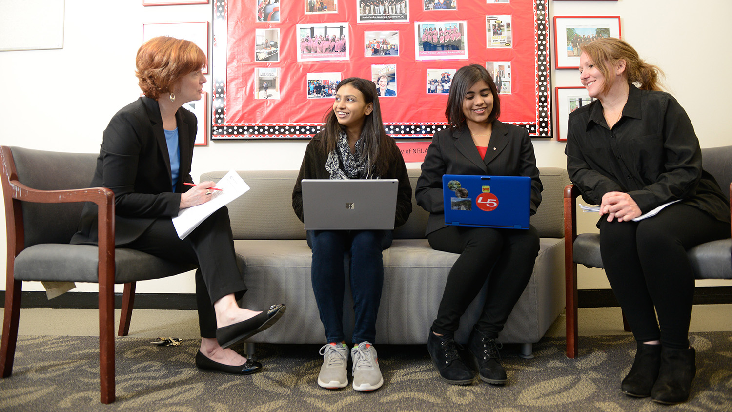 students sitting on couch with laptops