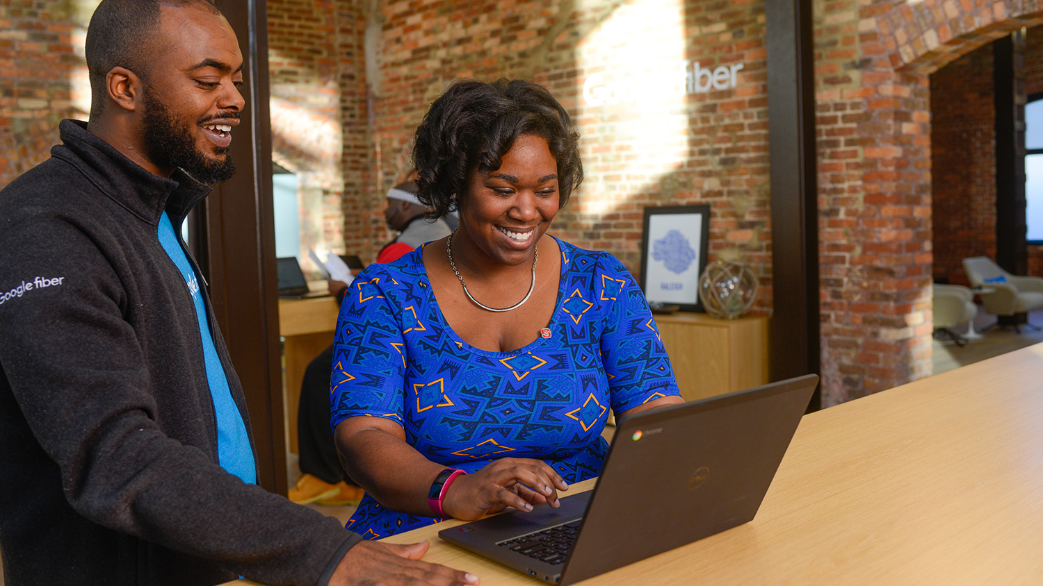 Tia Bethea interacts with a coworker at Google Fiber