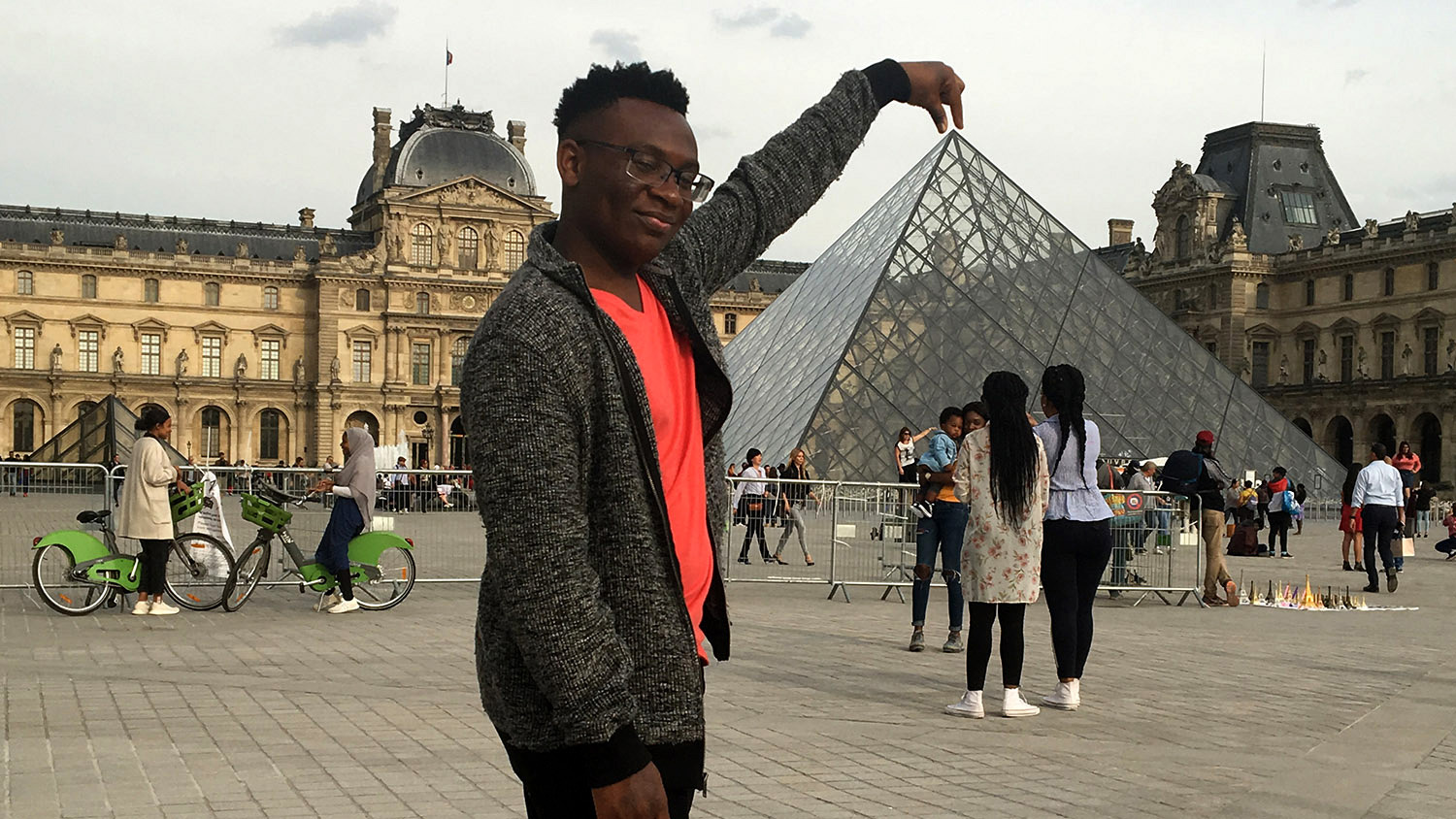 student standing in front of Louvre