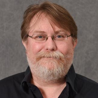 Headshot of Gene Melton