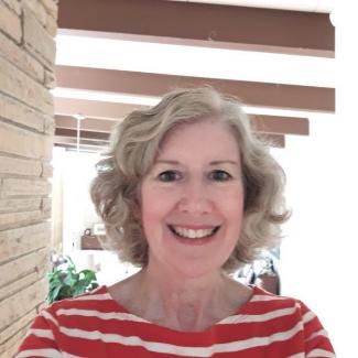 Headshot of Susan Navey-Davis