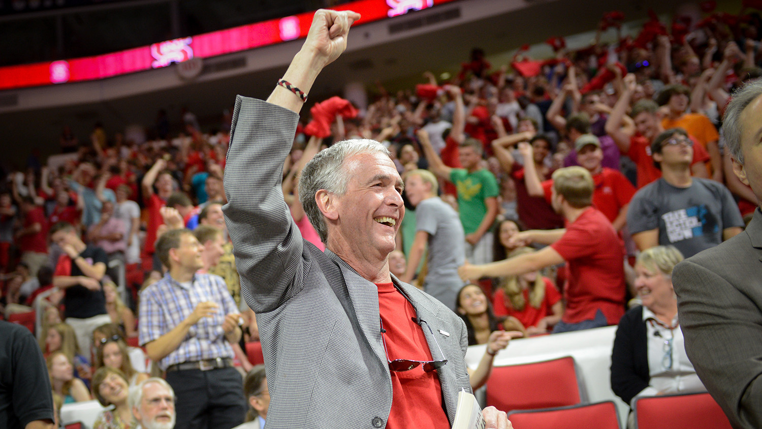 Dean Braden celebrates at an NC State sporting event
