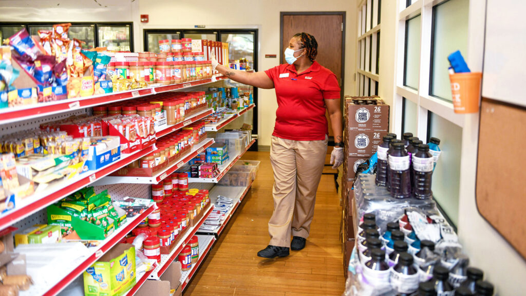 A worker preps a food pantry before it opens