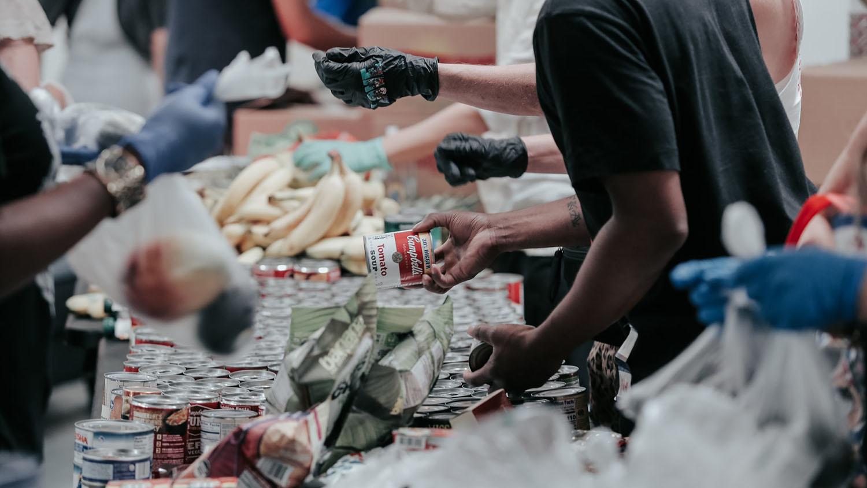 volunteers work at a food pantry