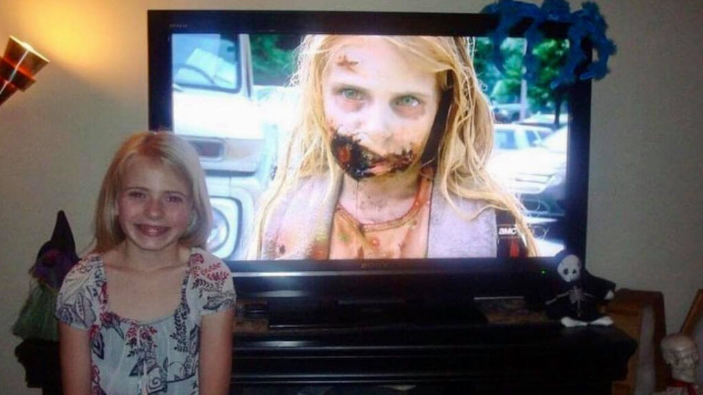 """Addy Miller sitting in front of TV with """"The Walking Dead"""""""