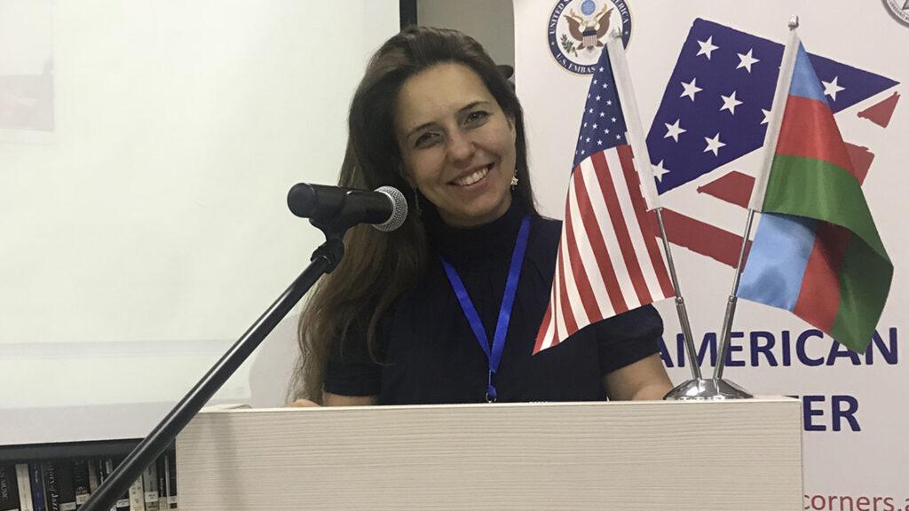 Kamilla Kravchenko standing at podium