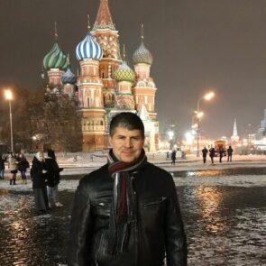 Pat Weninger standing in front of building in Russia