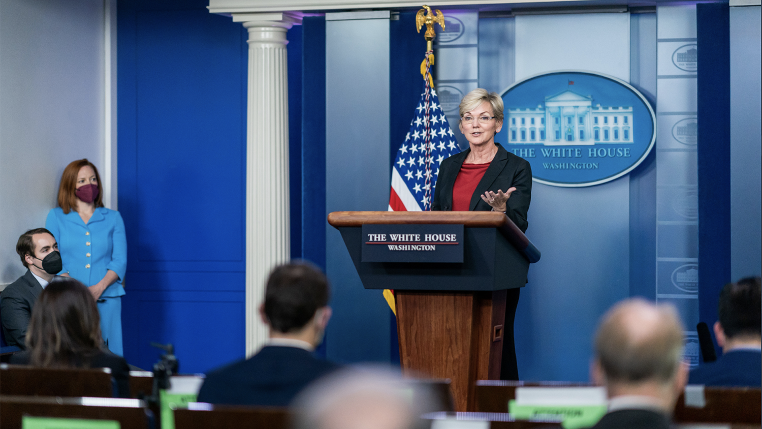 woman standing at podium in White House press room