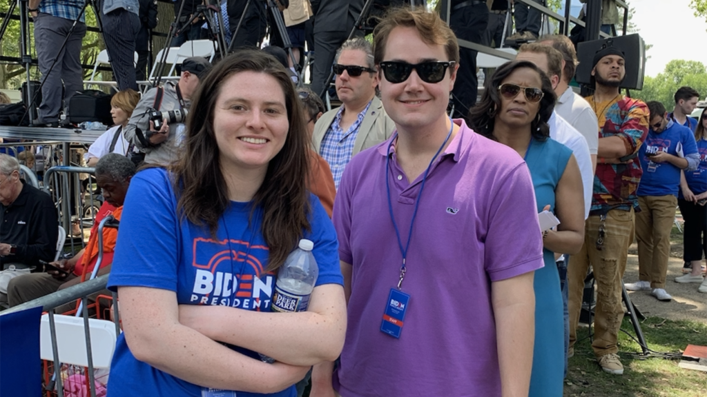Andrew Bates standing with woman during campaign
