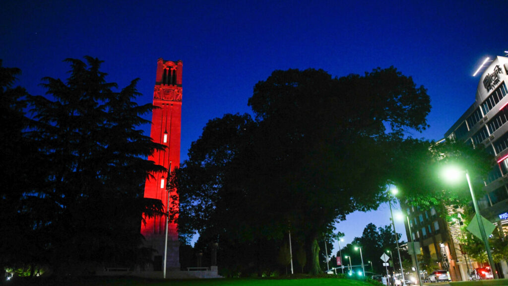 The NCState belltower, lit red