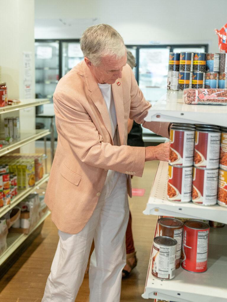 Dean Braden stocking shelf