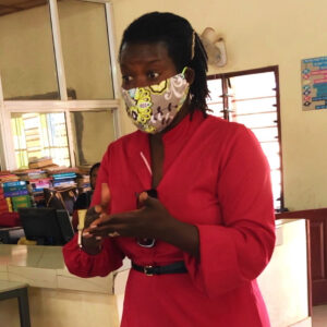 Haddy Njie wearing mask in front of class
