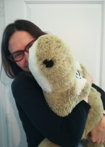 Rebecca Colby hugging toy alligator