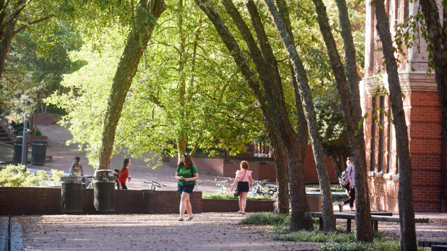 Students walk down the Caldwell Hall patio