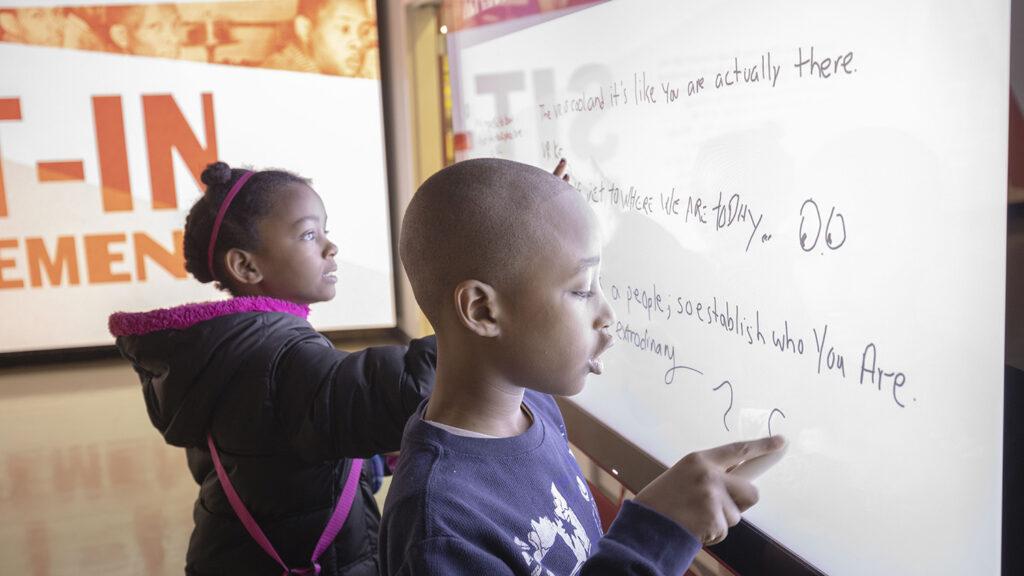 kids writing on digital white board