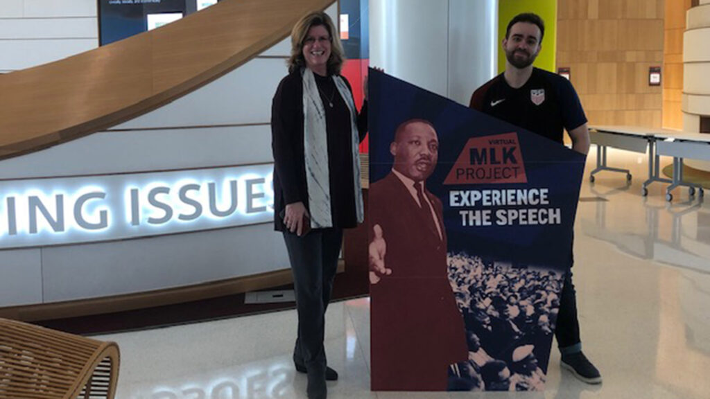 man and woman holding vMLK sign