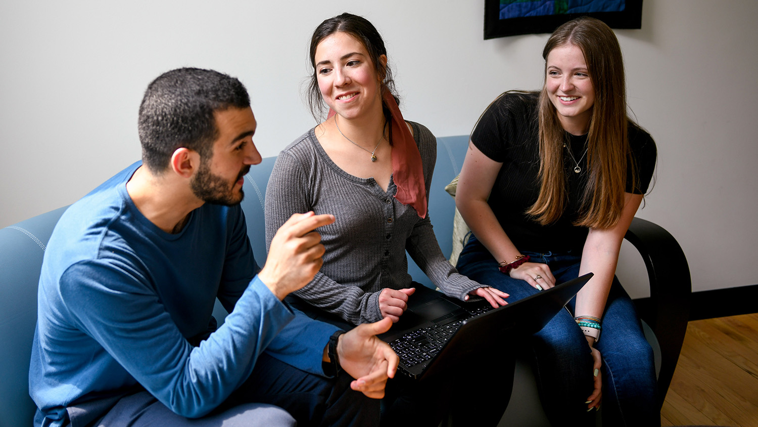students sitting in lounge and talking